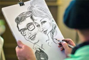Шаржист рисует портрет